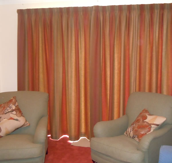 Curtains in warm autumn colours with matching cushions