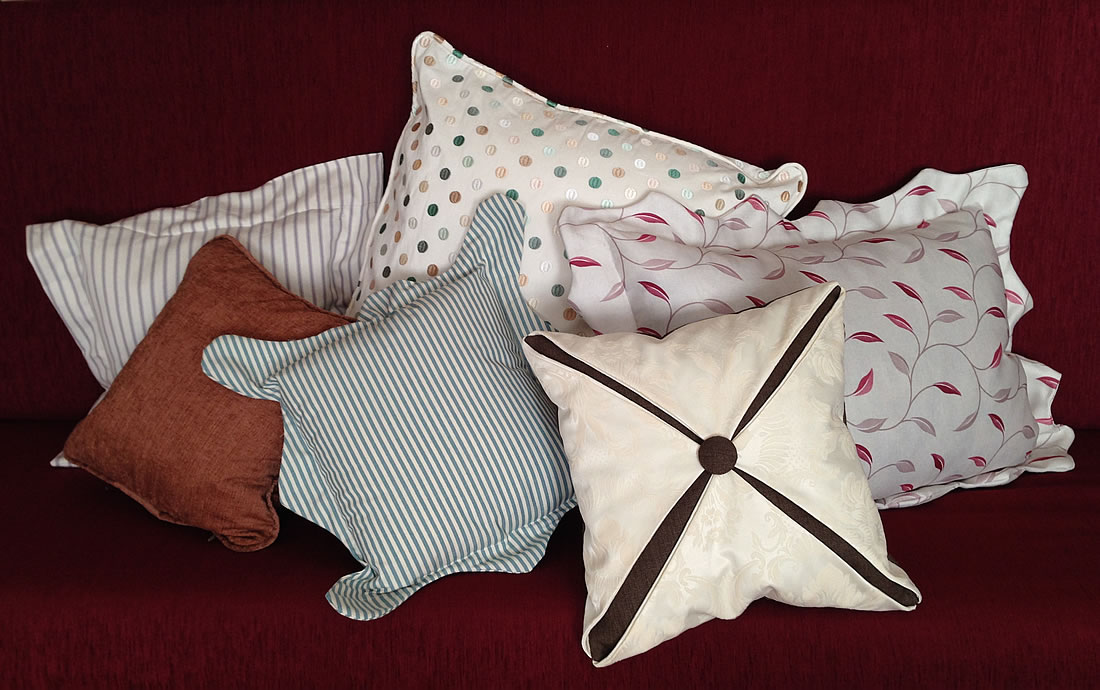 Various small cushions made by Window Dressing Oxford.