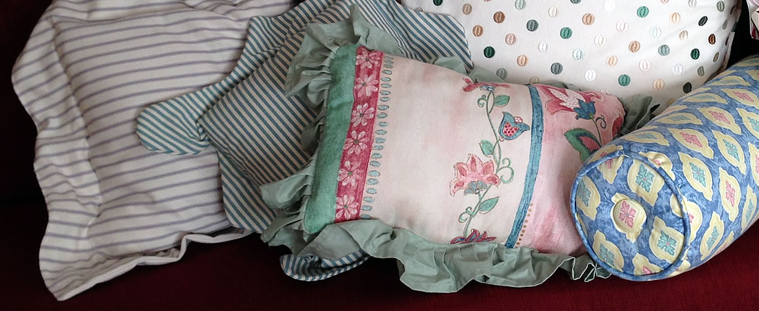 Zoomed-in picture of the detail of some smaller cushions made by Window Dressing Oxford. This shows piping, frills and covered buttons.